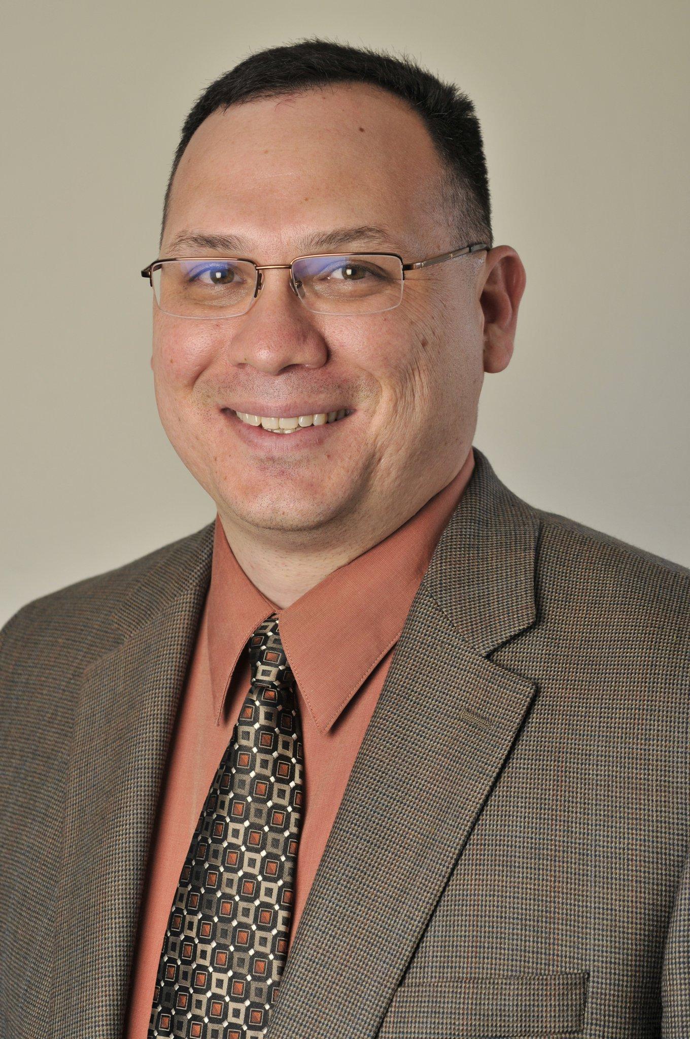 Dr Michael Nava